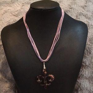 Purple glass fleur de lis pendant necklace